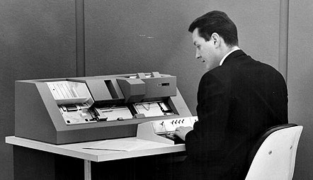 Man programming a punch card machine